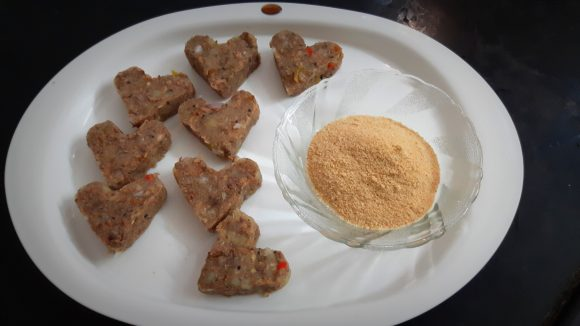raw cutlet and bread crumbs