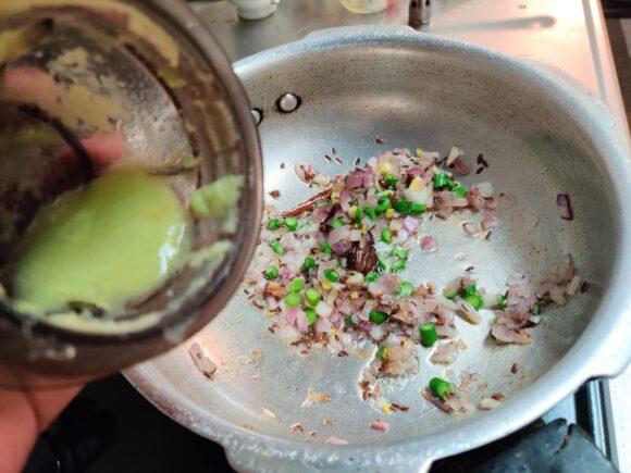 Add garlic shoot, green chili and garlic paste