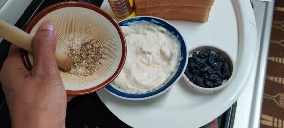 put curd, honey, cardamom powder and vanilla essence
