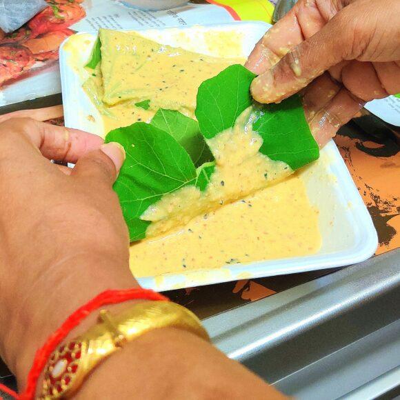 dip one leaf in the prepared batter of Besan