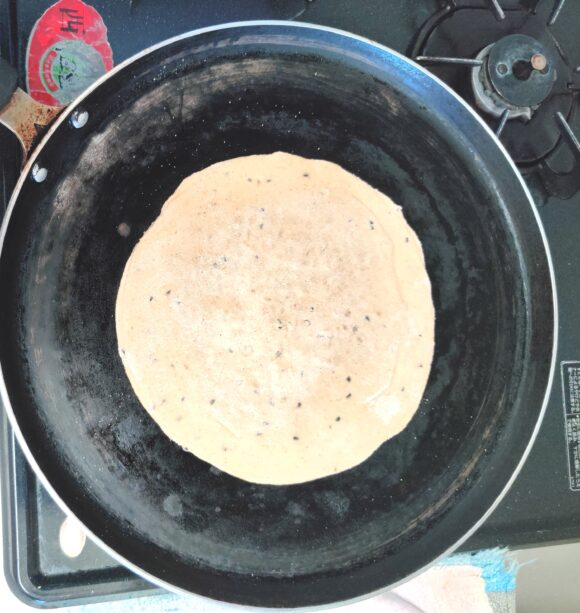 Place the rolled paratha