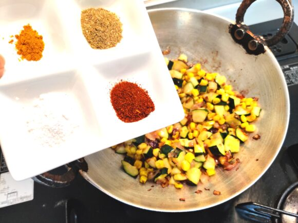 add Turmeric powder, Coriander powder, Chili powder, Dry mango powder and salt